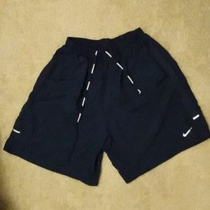 Nike dri fit running shorts with reflectors.